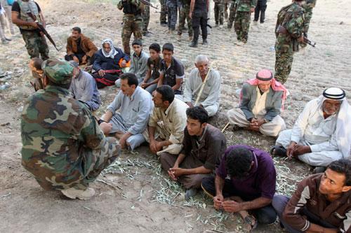 Hàng trăm người bị IS sát hại và chôn tập thể