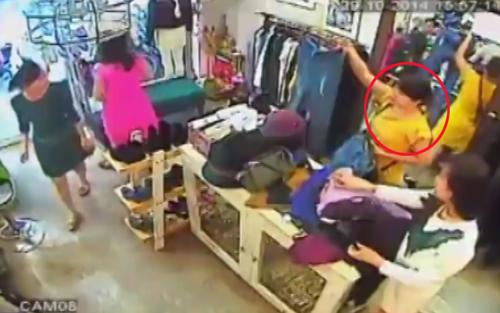 1 9507 1415340634 Người đẹp nhanh tay trộm iPhone 6 Plus trong shop Hà Nội