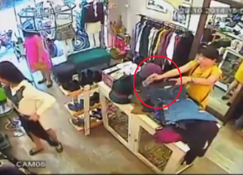 3 3461 1415340634 Người đẹp nhanh tay trộm iPhone 6 Plus trong shop Hà Nội