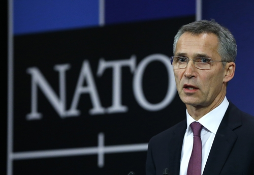 NATO Secretary General Jens Stoltenberg speaks at the Alliance's headquarters during a NATO foreign ministers meeting in Brussels December 2, 2014. Stoltenberg accused Russia late on Monday of violating a ceasefire agreement in eastern Ukraine by sending large deliveries of advanced weapons to pro-Russian separatists. REUTERS/Yves Herman (BELGIUM - Tags: POLITICS MILITARY)