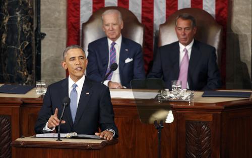 Tổng thống Obama đọc Thông điệp Liên bang tại Đồi Capitol. Phía sau ông là phó tổng thốngJoe Biden(trái)và Chủ tịch Hạ viện John Boehner.Ảnh: Reuters