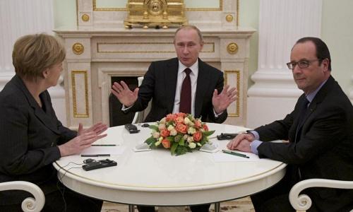Ba lãnh đạo Đức, Nga, Pháp trong cuộc thảo luận tại Moscow hôm qua. Ảnh: Twitter