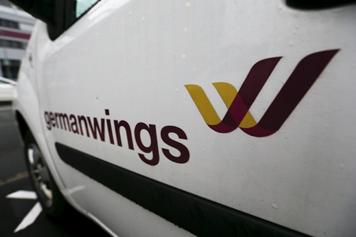 "A Germanwings logo is pictured at a door of a car outside the Germanwings headquarters at Cologne-Bonn airport March 28, 2015. Andreas Lubitz, the co-pilot who appears to have deliberately crashed Germanwings flight 4U9525 carrying 149 passengers into the French Alps received psychiatric treatment for a ""serious depressive episode"" six years ago, German tabloid Bild reported on Friday. REUTERS/Wolfgang Rattay"