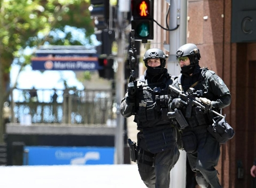 "Australia has warned of heightened threats from ""home-grown"" extremists and in 2014 police commandos were called after a jihadist gunman took 17 people hostage in Sydney (AFP Photo/Saeed Khan)"
