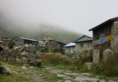 This photo taken on September 11, 2014 shows a general view of the village of Langtang, in the remote Nepalese district of Rasuwa bordering China's Tibet. Nine days after a 7.8-magnitude quake brought death and destruction to the Himalayan nation of Nepal, US helicopters on May 4, 2015 began to assess remote areas of Nepal devastated by the earthquake that killed more than 7,300 people. Many foreign victims were in the popular Langtang trekking region north of Kathmandu when the quake struck. AFP PHOTO / MOIRA SHAW
