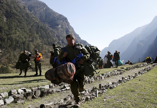 Israeli soldiers from the National Rescue Unit are evacuated from the Himalaya mountains after a mission to rescue climbers affected by last week's earthquake near Dhunche, Nepal, May 3, 2015. REUTERS/Olivia Harris