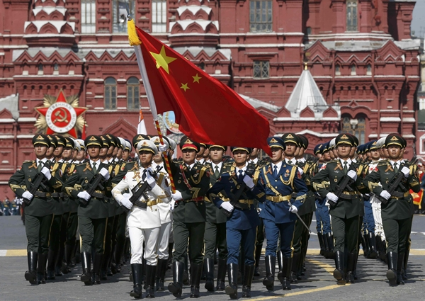 Chinese servicemen march during the Victory Day parade at Red Square in Moscow, Russia, May 9, 2015. Russia marks the 70th anniversary of the end of World War Two in Europe on Saturday with a military parade, showcasing new military hardware at a time when relations with the West have hit lows not seen since the Cold War. REUTERS/Sergei Karpukhin