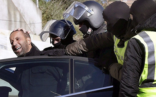 Spanish Civil Guard agents arrest an alleged Islamic State jihadist during an anti-terror operation in Barcelona Photo: EPA