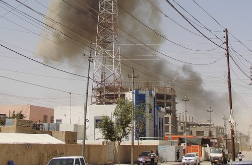 Smoke rises after a bomb attack in the city of Ramadi, May 15, 2015. Islamic State militants raised their black flag over the local government headquarters in the Iraqi city of Ramadi on Friday and claimed victory through mosque loudspeakers after overrunning most of the western provincial capital. If Ramadi were to fall it would be the first major city seized by the insurgents in Iraq since security forces and paramilitary groups began pushing them back last year. REUTERS/Stringer