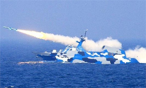 File photo shows a Chinese People's Liberation Army (PLA) Navy's missile ship attends a routine live-ammunition training, held by the Navy's East China Sea Fleet in the East China Sea in July last year. Photo: Xinhua