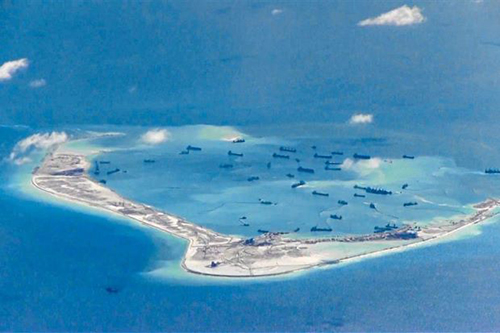 Work in progress: Chinese dredging vessels purportedly seen in the waters around Mischief Reef in the disputed Spratly Islands in the South China Sea.  Reuters