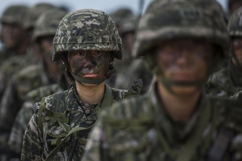A Republic of Korea Marine stands in formation during Exercise Cobra Gold 2014 at Hat Yao beach, Rayong, Thailand. Cobra Gold is a multinational military training exercise that includes South Korea and the United States. Photo by Sgt. Matthew Troyer/U.S. Marine Corps