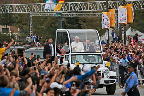 PopeFrancis waves to the crowd from the popemobile during a papal parade inPhiladelphia, Pennsylvania September 27
