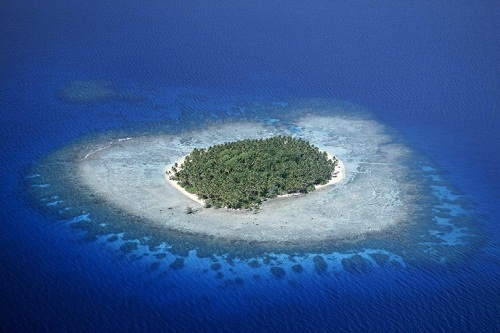 An island is land surrounded by water.