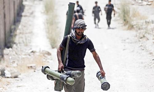 Quân nổi dậy Syria bắt tay dưới làn đạn Nga 2