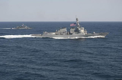 USS Lassen (DDG 82), (R) transits in formation with ROKS Sokcho (PCC 778) during exercise Foal Eagle 2015, in waters east of the Korean Peninsula, in this March 12, 2015, handout photo provided by the U.S. Navy.