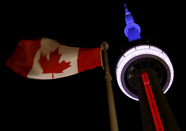 [Caption]Toronto's landmark CN Tower is lit blue, white and red in the colors of the French flag following Parisattacks
