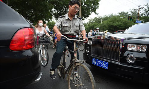 Cuộc chiến ôtô - xe đạp ở các siêu đô thị Trung Quốc 1