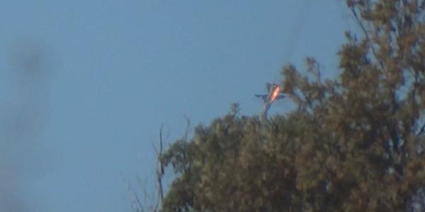 Hình ảnh Su-24 bốc cháy lao xuống vùng rừng núi. Ảnh: Reuters