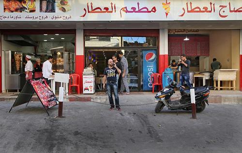 al-Attar đang là chủ của ba cửa hàng nhỏ ở Beirut. Ảnh: AP