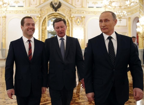 Russian President Vladimir Putin (R), walks with Prime Minister Dmitry Medvedev (L) and Kremlin chief of staff Sergei Ivanov on December 3, 2015 (AFP Photo/Dmitry Astakhov)