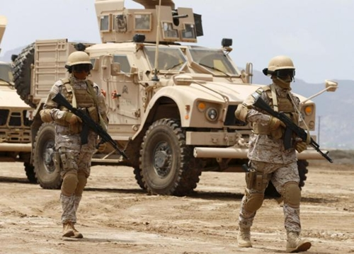 Saudi troops walk at their base in Yemen