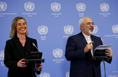Iranian Foreign Minister Javad Zarif and the High Representative of the European Union for Foreign Affairs and Security Policy Federica Mogherini address a news conference at the United Nations building in Vienna, Austria, January 16, 2016.
