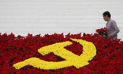 A man arranges flowers used to set up a decoration with the Communist logo promoting the upcoming 12th national congress of the Vietnam's Communist Party at the national convention center, the congress venue, in Hanoi A man arranges flowers used to set up a decoration with the Communist logo promoting the upcoming 12th national congress of the Vietnam's Communist Party at the national convention center, the congress venue, in Hanoi, January 18, 2016. REUTERS/Kham