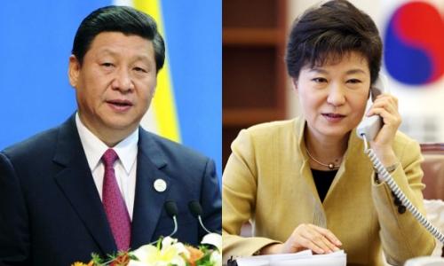 Chủ tịch Trung Quốc Tập Cận Bình và Tổng thống Hàn Quốc Park Geun-hye. Ảnh: Yonhap