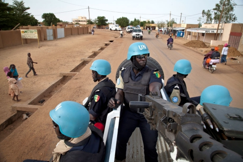 Senegalese police officers serving with the UN Multidimensional Integrated Stabilization Mission in Mali (MINUSMA), patrol the streets of the city of Gao, in Mali. UN Photo/Marco Dormino