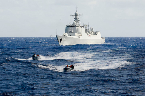 [Caption]A boarding team from the People's Liberation Army (Navy) Haikou (DD 171) makes way toward the U.S. Coast Guard Cutter Waesche (WMSL 751) July, 16, 2014, during a Maritime Interdiction Operations Exercise (MIOEX) as part of Rim of the Pacific (RIMPAC) Exercise 2014.
