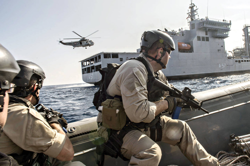 [Caption]U.S. Navy special operations forces train with the Indian navy in October 2015 during a visit, board, search and seizure drill as part of Exercise Malabar in the Bay Of Bengal. The U.S., India and Japan plan to conduct similar exercises in the northern waters of the Philippine Sea this year. PHOTO: MCS2 JOE BISHOP/PLANET PIX/ZUMA PRESS