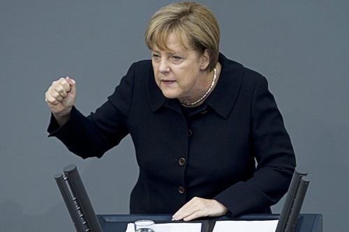 """Bà Merkel vững vàng sau """"ngày chủ nhật kinh hoàng"""" 1"""