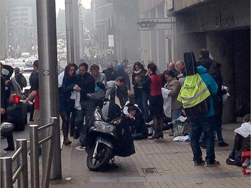[Caption]In a photo posted on Instagram, victims of the explosion inside the Maalbeek metro station wait above ground for medical treatment, March 22, 2016.