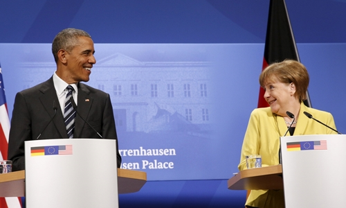 Cặp bài trùng quốc tế Obama và Merkel 1