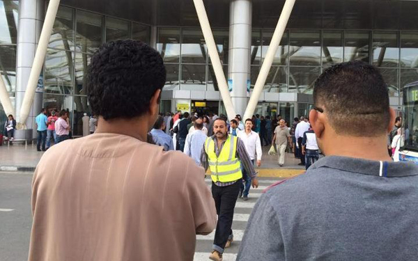 Anxious relatives await information from workers at Charles de Gaulle airport in Paris CREDIT: AP