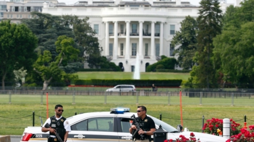 White House grounds were shut down to pedestrian traffic, locking staff members and reporters indoors Friday after the White House is placed on lockdown for a shooting nearby. (Alex Brandon/Associated Press)