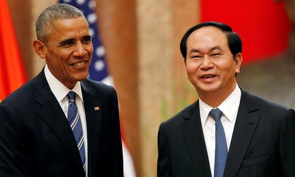 Chủ tịch nước Trần Đại Quang (phải) và Tổng thống Mỹ Barack Obama. Ảnh: Reuters.