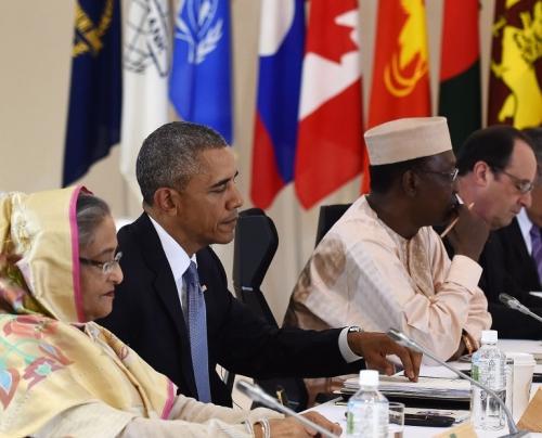 Tổng thống Mỹ Barack Obama (giữa) trong hội nghị G7 mở rộng. Ảnh: AFP