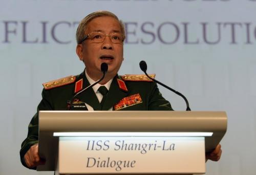 Thượng tướng Nguyễn Chí Vịnh có bài phát biểu quan trọng tại phiên họp sáng nay. Ảnh: AFP