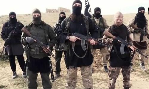 """Suy yếu, IS """"bắt quàng làm họ"""" với những kẻ xả súng 1"""