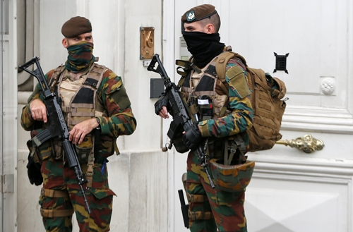 Belgian soldiers stand guard outside the prime minister's office building in Brussels