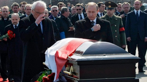Russia's Prime Minister Vladimir Putin and Poland's Ambassador to Russia Jerzy Bahr cross themselves near the coffin of Poland's late President Lech Kaczynski as they attend a farewell ceremony at the Smolensk airport, Poland.