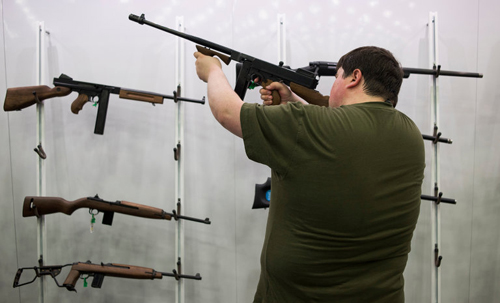 Examining firearms at an exhibit during the 145th National Rifle Association convention in Louisville, Ky., in May.CreditTy Wright for The New York Times