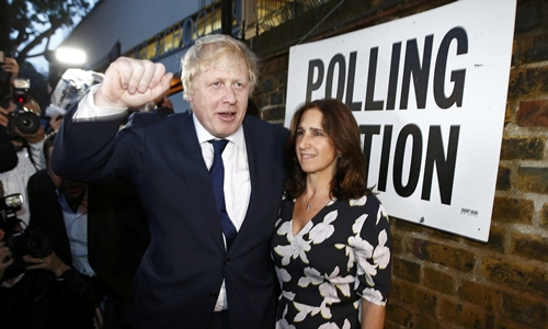 Former London Mayor Boris Johnson and his wife Marina Wheeler leave after voting in the EU referendum, at a polling station in north London