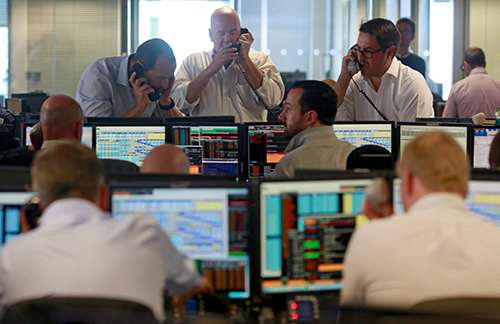 Traders from BGC, a global brokerage company in London's Canary Wharf financial centre react during trading June 24, 2016 after Britain voted to leave the European Union in the EUBREXIT referendum. REUTERS/Russell Boyce