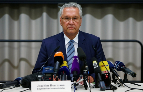 Bavarian Interior Minister Herrmann addresses news conference after explosion in Ansbach