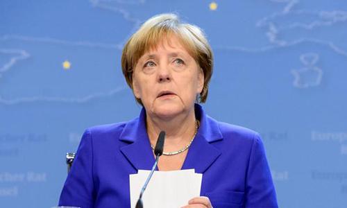 Thủ tướng Angela Merkel trong cuộc họp báo hôm nay. Ảnh: DPA