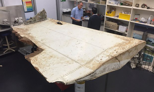 [Caption]t of a wing flap from missing Malaysia Airlines passenger jet MH370. Photograph: AFP/Getty Images