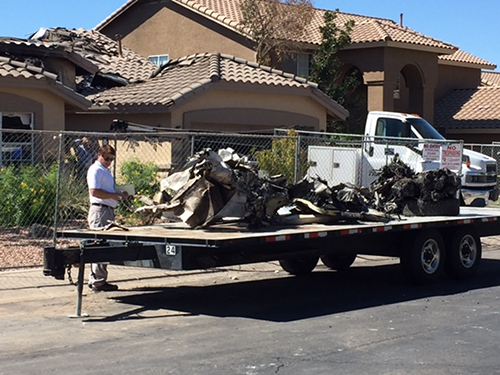 [Caption]Wreckage from a plane that crashed into a home in Gilbert, Ariz., sits on a flatbed on Sunday, Sept. 18, 2016.